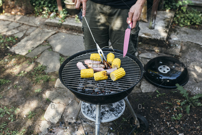 Sausages and corn on a BBQ grill