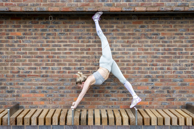 Woman doing yoga stretches her legs in the air