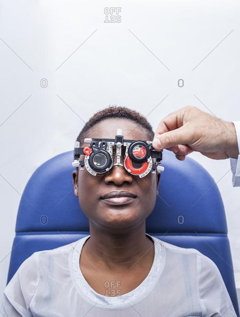 Studying a woman's eyesight - Offset