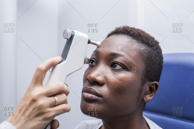 Eye examination with an ophthalmologist, close up