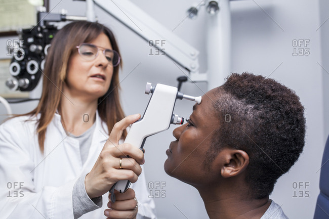 Eye examination with an ophthalmologist, side view