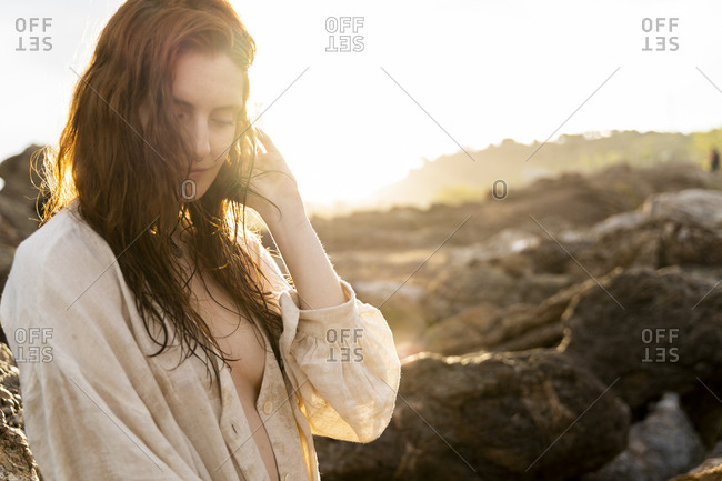 Portrait of redheaded young woman at sunset