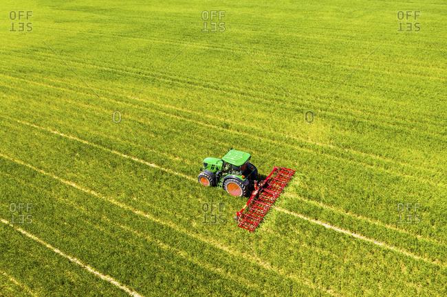 Aerial view of tractor on field- soil loosening- Hochtaunuskreis- Hesse- Germany