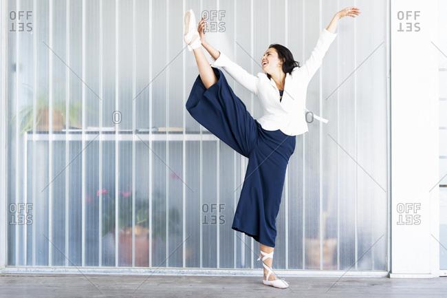 Female ballet dancer lifting her leg