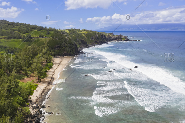 Aerial view over Pacific Ocean and West Maui Mountains- Punalau Beach- Maui- Hawaii- USA