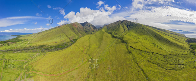 Aerial view over West Maui Mountains and Pacific Ocean with Puu Kukui- Maui- Hawaii- USA