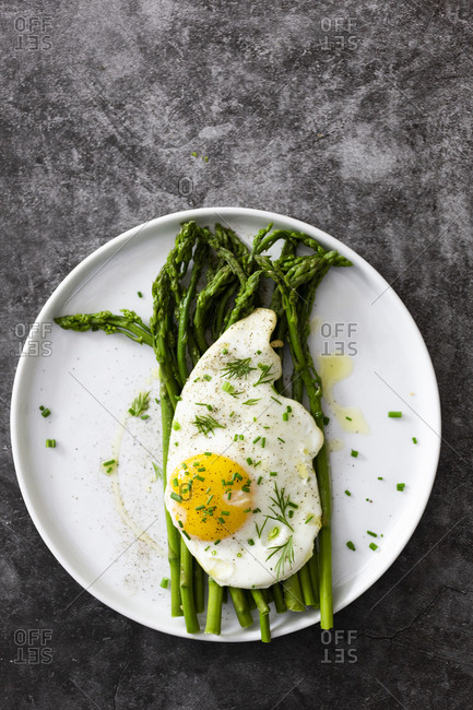 Asparagus and fried egg on a plate