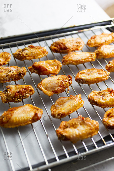 Preparing of spicy chicken wings- grid