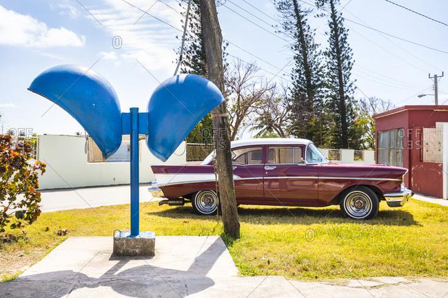 March 13, 2018: Parked red vintage car- Havana- Cuba
