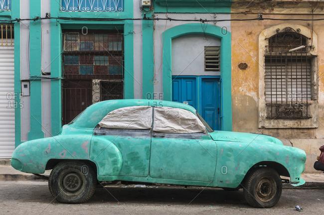 March 17, 2018: Parked damaged vintage car- Havana- Cuba