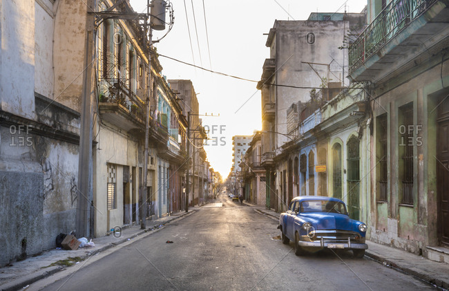 March 17, 2018: Parked blue vintage car on empty street at evening twilight- Havana- Cuba
