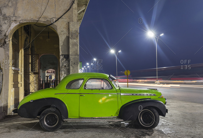 March 19, 2018: Parked vintage car at night- Havana- Cuba