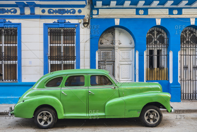 March 19, 2018: Parked green vintage car- Havana- Cuba