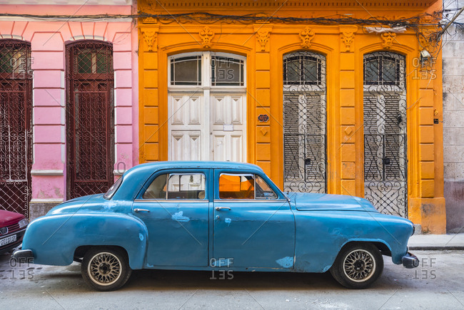 March 19, 2018: Parked blue vintage car in front of residential house- Havana- Cuba