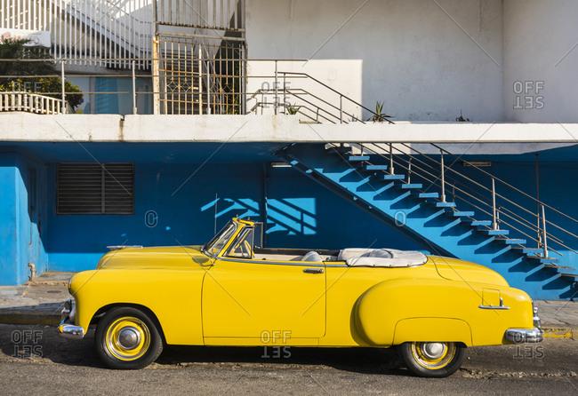 March 19, 2018: Parked yellow vintage car- Havana- Cuba