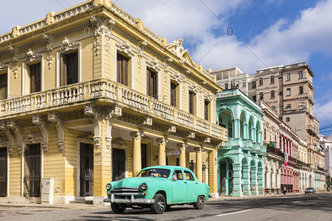 March 11, 2018: Vintage car driving in front of colonial buildings- Havana- Cuba