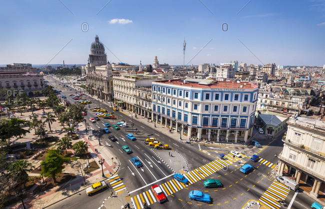 March 10, 2018: View to street with cars- Cocotaxi and carriage from above- Havana- Cuba