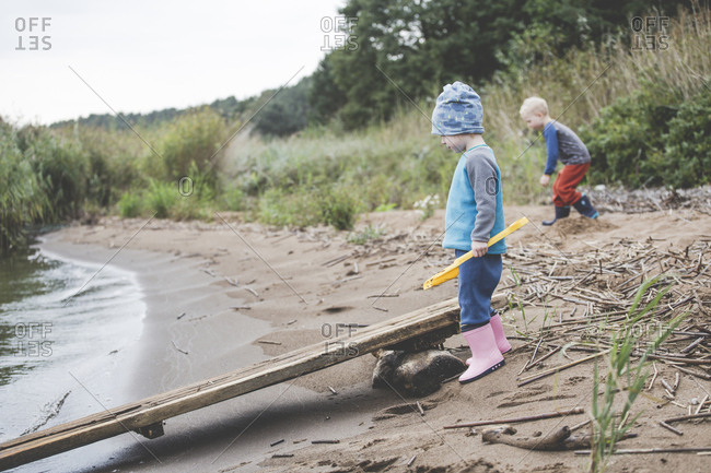 Boy and girl playing on a wild sand beach