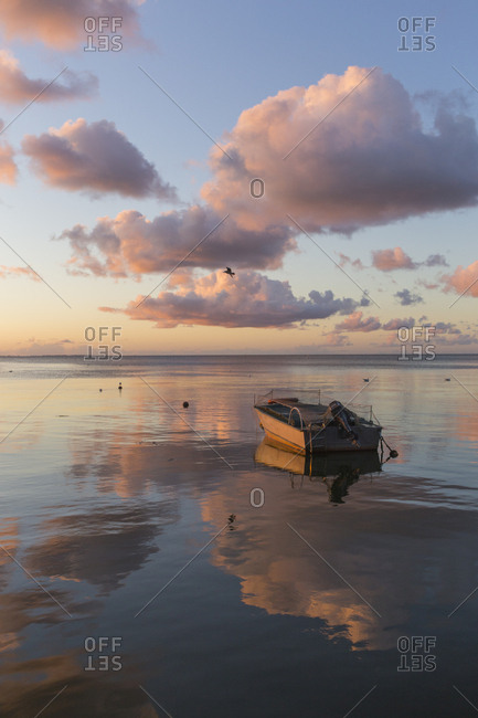 Fishing boat on the sea at sunrise- Curonian Spit- Lithuania