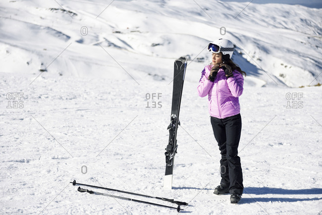 Woman wearing ski clothing getting ready to ski at the Sierra Nevada- Andalusia- Spain