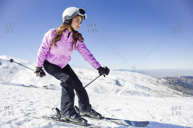 Woman skiing under blue sky- Sierra Nevada- Andalusia- Spain