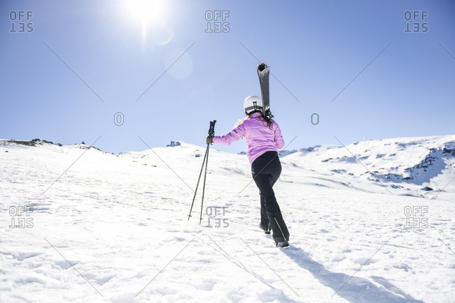 Skier walking uphill in snow-covered landscape- Sierra Nevada- Andalusia- Spain