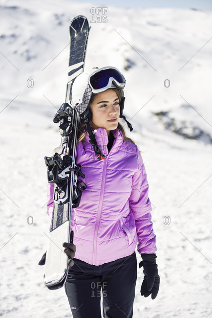 Woman carrying her skis over her shoulder- Sierra Nevada- Andalusia- Spain