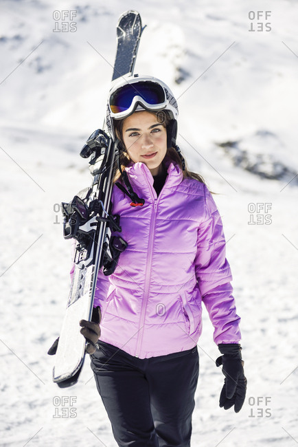 Portrait of woman carrying her skis over her shoulder- Sierra Nevada- Andalusia- Spain