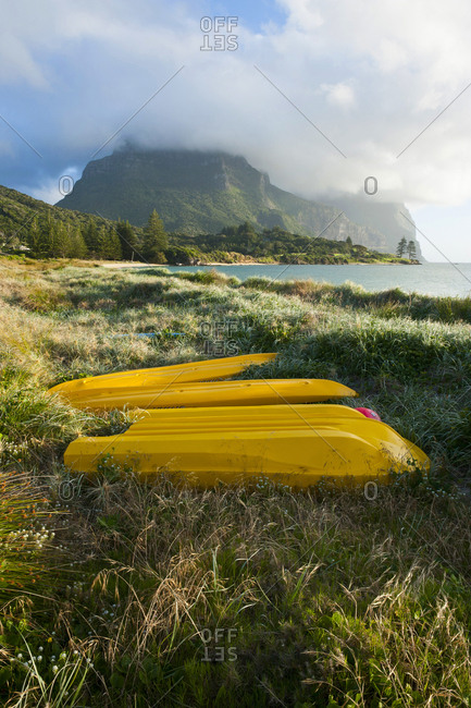Canoes before Mount Lidgbird and Mount Gower on Lord Howe Island- New South Wales- Australia