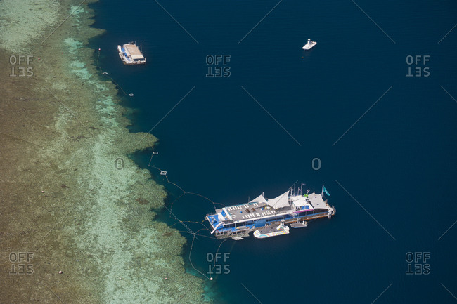 Aerial view of the great barrier reef and excursion boat- Queensland- Australia