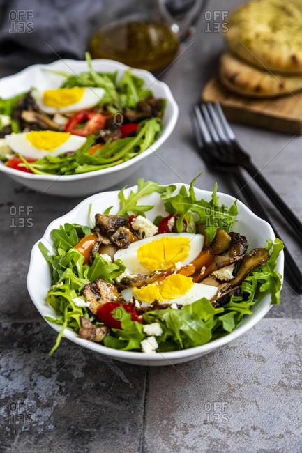 Rocket salad with fried champignons- hard-boiled egg- tomatoes and feta