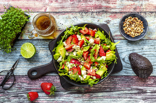 Strawberry avocado salad with feta- rocket- pine nuts and cress
