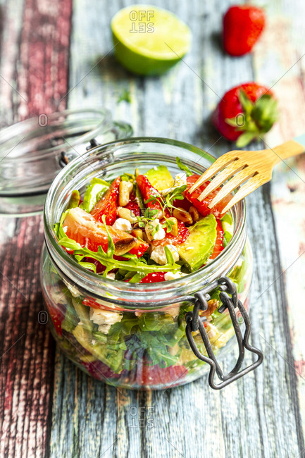 Strawberry avocado salad with feta- rocket and pine nuts in jar