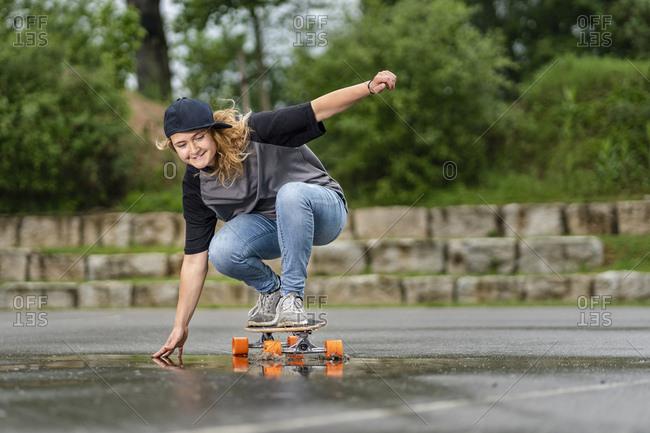 Young woman balancing on skateboard
