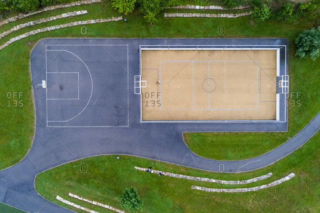 Young woman playing basketball- aerial view