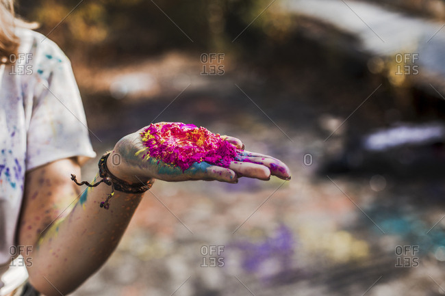 Girl holding Holi powder colors- Germany