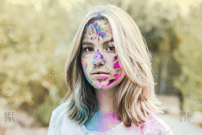 Girl Holi powder colors in her face- Germany
