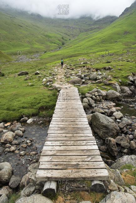 Trekking along Mickeldon Valley in Great Langdale towards Bowfell in the Lake District