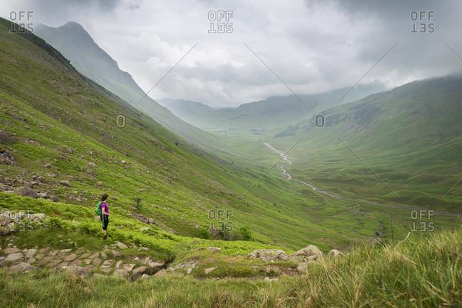 Crossing a stream in Mickeldon Valley in Great Langdale towards in the Lake District