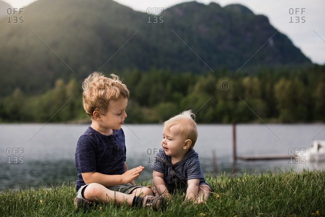 Boy showing baby brother how to high-five