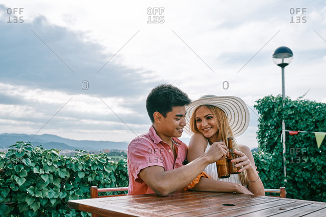 a couple drinking beer outside and having a good time