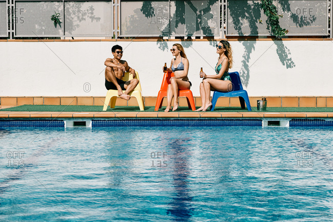 a group of people by the pool having a good time