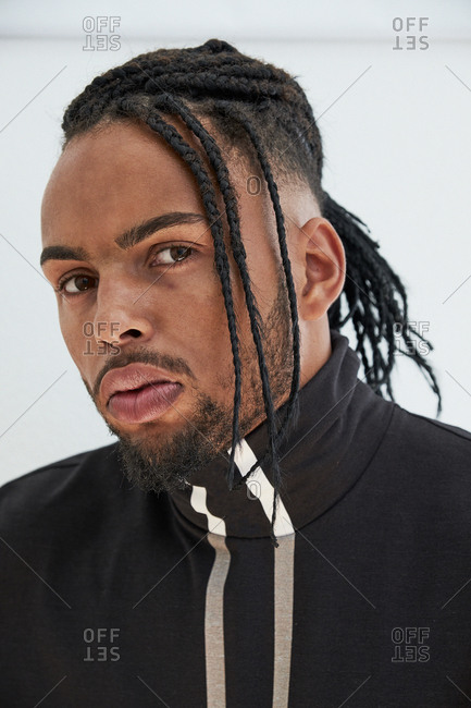 African American man with braids looking at camera