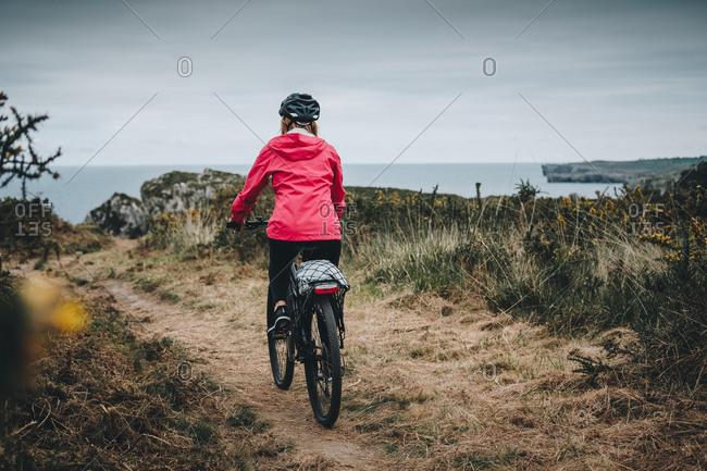 Female riding mountain bike