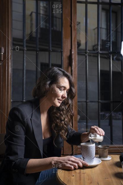 Woman drinking coffee latte in coffee shop