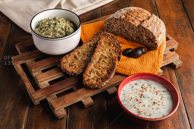 Tasty sauces decorated with sesame seeds and lush bread