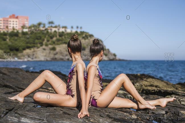 Graceful gymnasts training on rocks