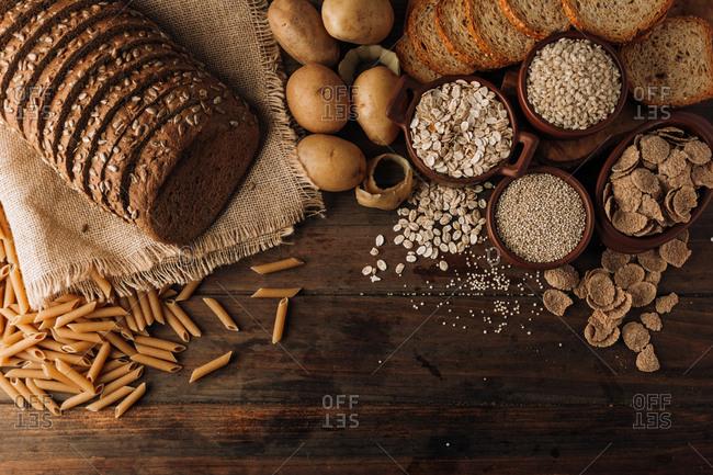Wholegrain food and freshly baked rye bread on table