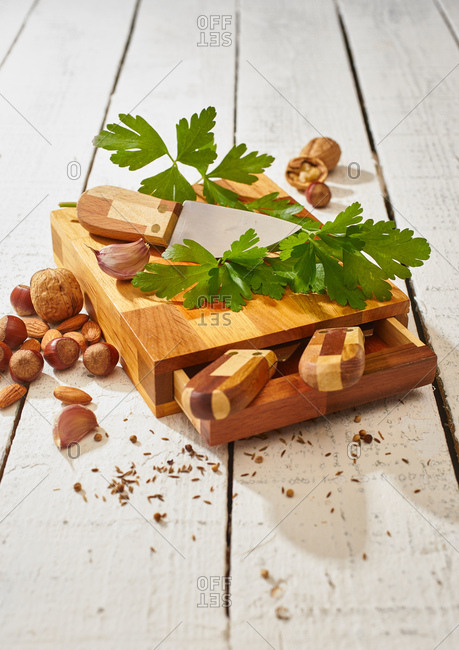 Ripe green parsley and sharp knife on wooden cutting board set