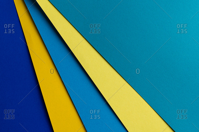 Layout of colorful cardboard sheets in blue and yellow shades